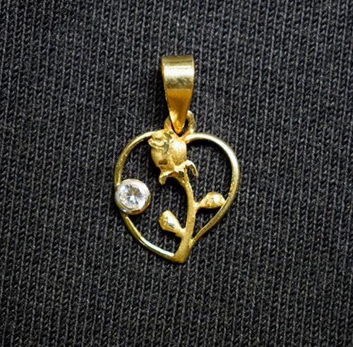 colgante oro flor y circonio